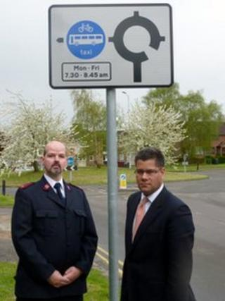 Mr Guest (left) and Alok Sharma MP (Cons) for West Reading (right)outside the bus lane sign