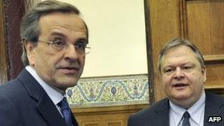 Leader of the New Democracy conservatives, Antonis Samaras (L) meets Pasok leader, Evangelos Venizelos at the Greek Parliament in Athens on May 11, 2012
