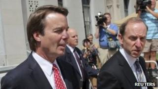 John Edwards exits a federal courthouse next to one of his defense lawyers, Abbe Lowell (R) in Greensboro, North Carolina 10 May 2012