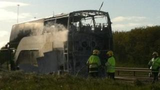 The bus on fire at the side of the motorway Pic: Patricia McBride
