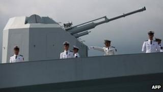 Chinese navy servicemen onboard the Chinese missile frigate Yuncheng (571) in Hong Kong on 30 April 30 2012