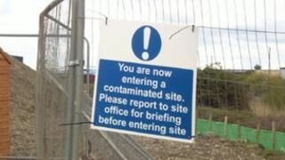 Contaminated land sign on the perimeter fence of the site
