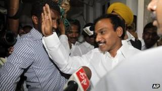 Former Indian Telecom Minister, and Dravida Munnetra Kazhagam (DMK) party lawmaker Andimuthu Raja, right, waves to the media at his official residence in New Delhi, India, Tuesday, May 15, 2012.