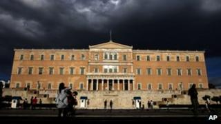 People walk outside the Greek parliament on Tuesday, 15 May 2012