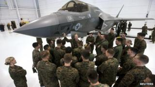 A group of US soldiers are shown an F-35 fighter jet at Eglin Air Force Base, Florida 24 February 2012