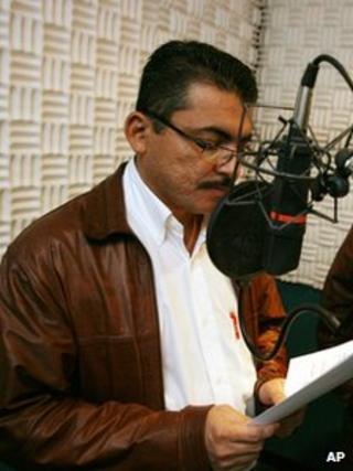 In this undated image released by HRN Radio, Alfredo Villatoro speaks during a program at the radio station in Tegucigalpa, Honduras