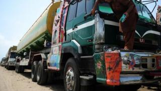 A Pakistani truck - used to transport fuel to Nato forces in Afghanistan - parked near oil terminals in the port city of Karachi
