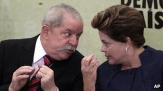 Brazil's President Dilma Roussef (right) talks to her predecessor Luiz Inacio Lula da Silva during the inauguration of the truth commission