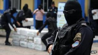 Members of the police drug squad guard at least 400 kg of cocaine seized in La Mosquitia on May 7, 2012.
