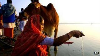 A Hindu prays on the banks of Sangam, the confluence of river Ganges