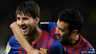 Lionel Messi (left) and Sergio Busquets of Barcelona celebrate a goal