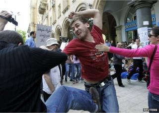 A protester (left) fights with a gay rights activist in Tbilisi, 17 May