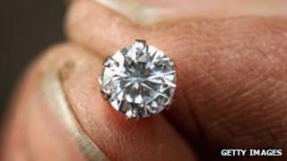Diamond and fingertips generic image