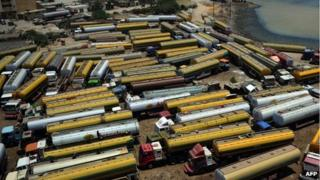 Tanker trucks, used to transport fuel to NATO forces in Afghanistan, are seen parked near oil terminals in Pakistan's port city of Karachi on May 15, 2012.