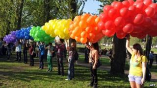 Gay activists with balloons in St Petersburg, Florida 17 May 2012