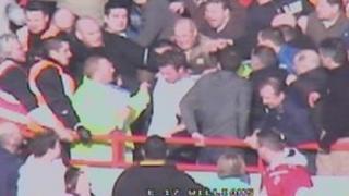 Darren Priaulx (centre, white top) is attacked