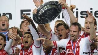 Ajax players celebrate winning the 2011/12 Dutch Eredivisie championship