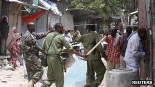 Somali government soldiers patrol the Bakara market in Mogadishu (file image from 30 April)