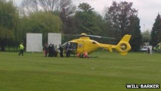 The air ambulance landing on nearby Hales Meadow Cricket pitch (copyright: Will Barker)