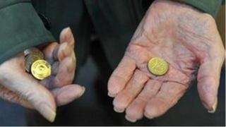 Old person holding coins