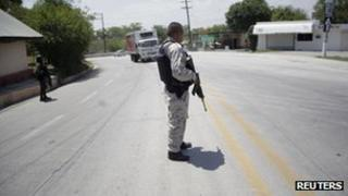 Mexican soldiers patrol road