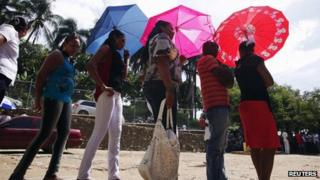 Voters queue in Santo Domingo to cast their votes in the Dominican Republic's election
