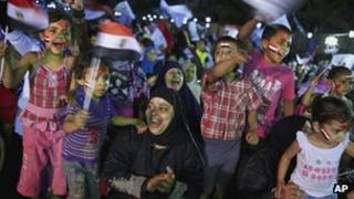 Children wave Egyptian national flags at a rally in support of the Muslim Brotherhood candidate Mohammed Mursi