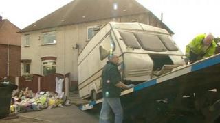 Caravan being taken from house