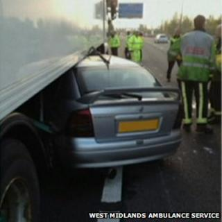 Car trapped under lorry on M6