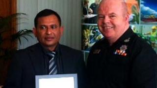 Abdul Aziz receiving award