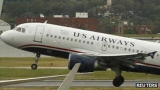 A US Airways plane takes at Ronald Reagan National Airport in Washington on 23 April 2012