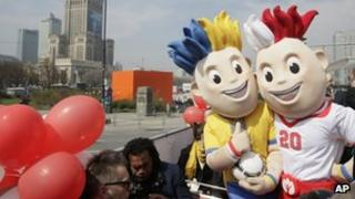 Euro 2012 mascots pose in Warsaw