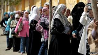 Voters queue outside a polling station in Cairo during Egypt's presidential election on 23 May 2012