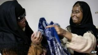 Acid attack survivors Naila Farhat and Naziran Bibi at the Al-Shifa trust eye hospital in Rawalpindi, Pakistan, in December 2009