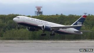 US Airways flight 787 takes off on 22 May 2012 after landing in Bangor, Maine, following a security scare on board