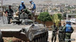 UN observers examine a Syrian army tank during a field visit to the al-Zabadani area, near Damascus on 6 May 2012