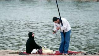 A man and a woman fishing