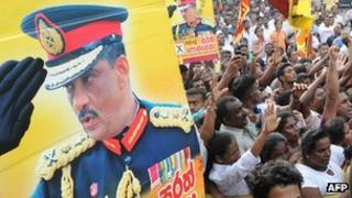 Supporters of Sri Lanka's former army chief Sarath Fonseka celebrate as he leaves the main prison in Colombo on May 21, 2012.