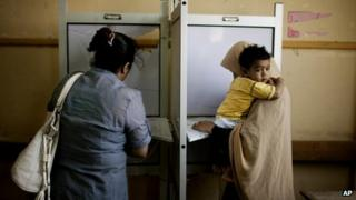 Egyptian voters cast their votes during the second day of presidential elections in the Mataraya neighbourhood of Cairo, Egypt, Thursday