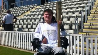Alex Jordan with the Olympic torch
