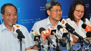 Workers' Party candidate Png Eng Huat (centre) celebrates