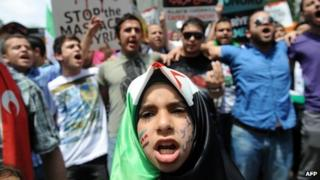 Demonstrators protest in front of the Syrian consulate in Istanbul on 27 May 2012
