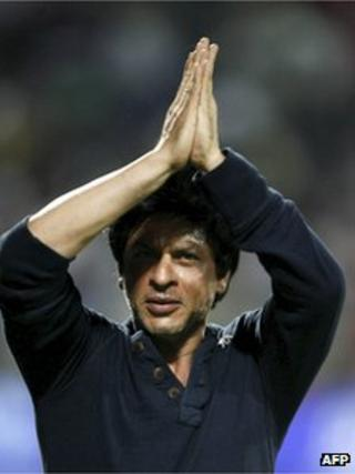 Kolkata Knight Riders co-owner and Bollywood star Shah Rukh Khan, greets the crowd as he celebrates his team's victory in their Indian Premier League (IPL) cricket playoff match against Delhi Daredevils in Pune, India, Tuesday, May 22, 2012