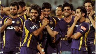 Kolkata Knight Riders owner and Bollywood actor Shah Rukh Khan (3rd R) celebrates with his teammates after they won the DLF IPL Twenty20 Champions Trophy in a final match against Chennai Super Kings at the M.A. Chidambaram Stadium in Chennai on May 27, 2012.
