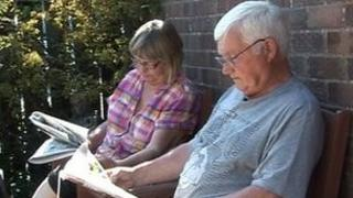 Stroke patient Norman Curtis reading a newspaper