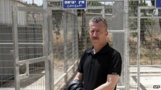 Bassem Tamimi stands outside Israel's Ofer military court near the town of Ramallah in the West Bank on 20 May