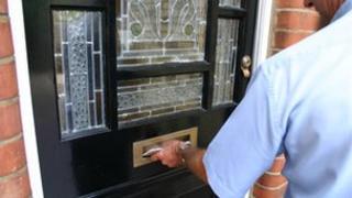 Postman delivering letter
