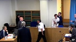 Protester enters Leveson court room