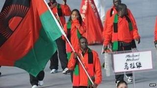 Athlete Charlton Nyirenda (C) Malawi's flag bearer parades in front of his delegation during the 2008 Beijing Olympic Games opening ceremony on August 8, 2008 at the National Stadium in Beijing.