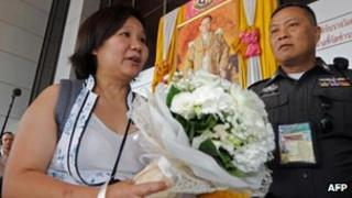 Chiranuch Premchaiporn, director of Prachatai news website arrives at a court in Bangkok 30 April, 2012